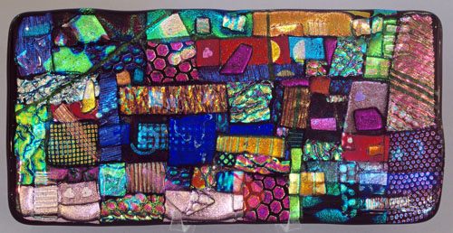 This dichroic glass tile was made by Springfield artisan Kathy McCormick. The tile is just the beginning phase for the making of glass jewelery