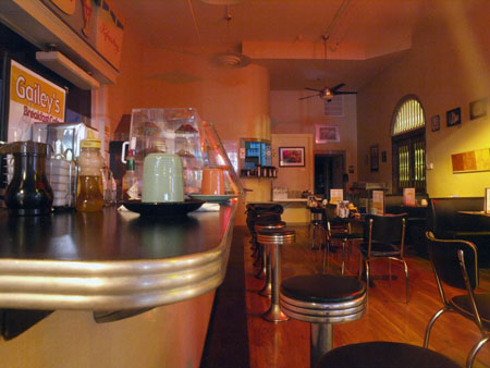 An interior view from the outside looking in at Gailey's Breakfast Cafe.
