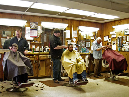 A typical Saturday at the barber shop on  Walnut Street.