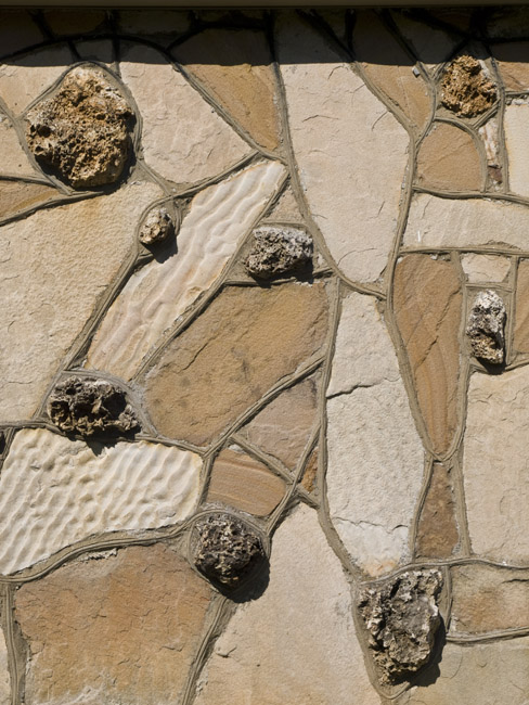 A detail from the facade of an Ozark Giraffe house with sandstone