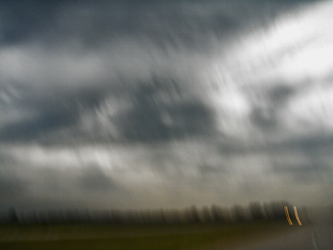 The impressionistic landscape, shot hand held outside of the driver's window on a wet drive home