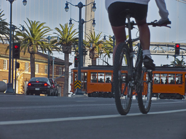 A leisurely pedal down San Francisco's Embarcedero near the Ferry Terminal, circa 2001