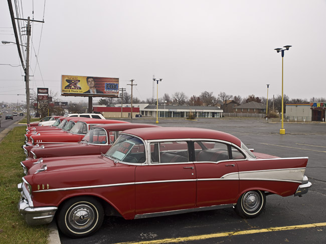 A line of 1957 Chevrolets, all are for sale
