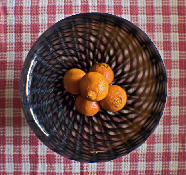 An orange and glass still-life
