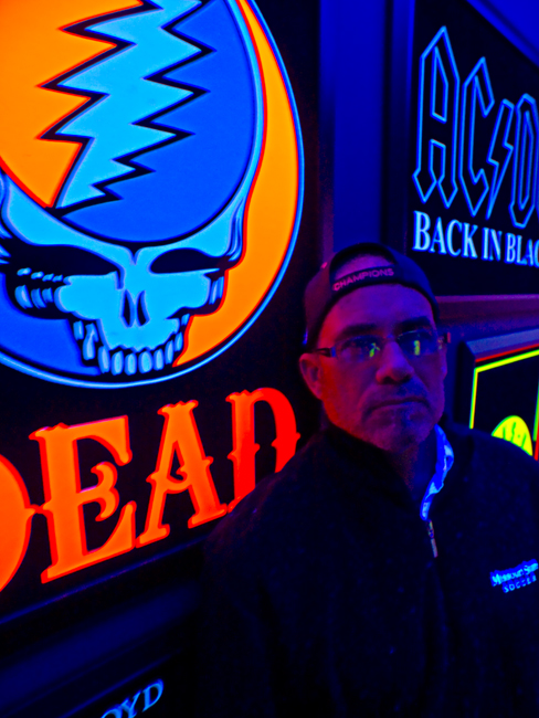 An available black light portrait of David Massey at Classic Rock Coffee