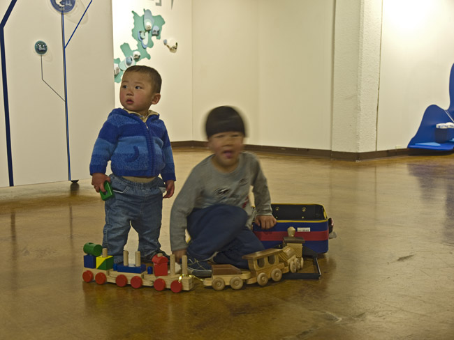 Playing with trains in the Gallery at the Pool Art Center