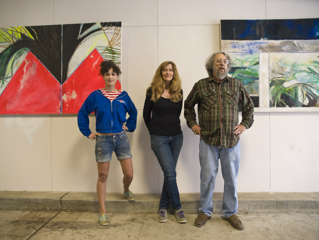 Sophie Parker with her paintings and her creators Jane and Tom