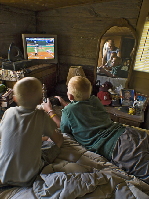 A great Uncle watching and two cousins playing xBox baseballA great Uncle watching and two cousins playing xBox baseball