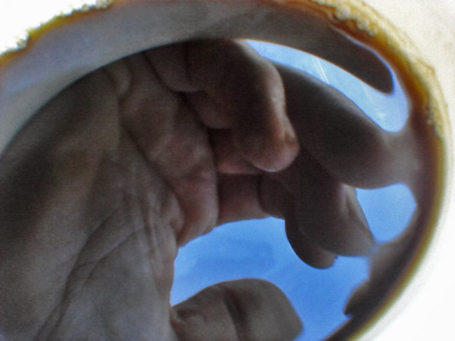 Black Coffee reflection of my left hand