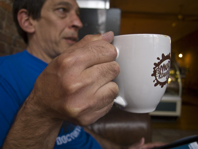 Todd's right hand and coffee cup