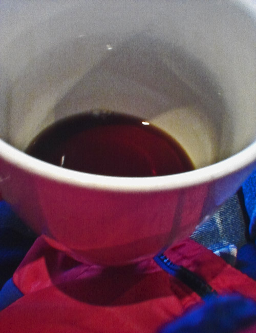 Composition with Coffee and Red Patagonia Jacket