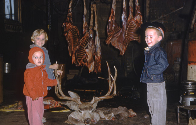 Elisa, Greg and myself posed in front of a Mule Deer my father shot, circa 1959