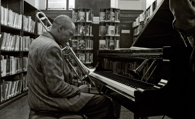 Julian Priester tuned his trombone before a night of music at the Berkeley Public Library, circa 1994