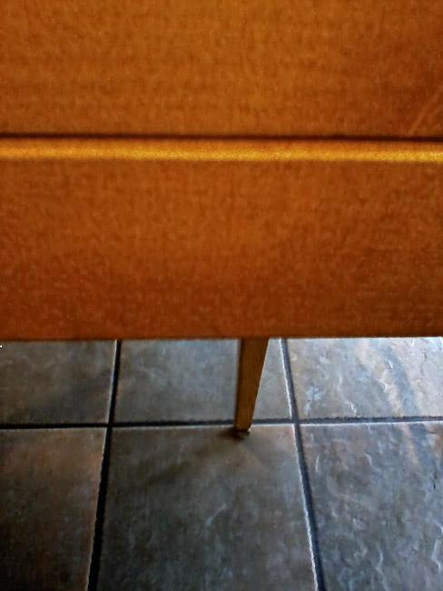 Table, chair leg and ceramic tile composition