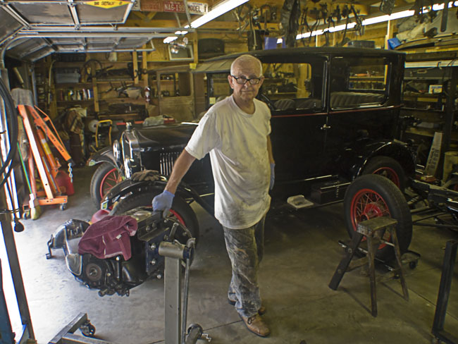 Fred Puckett in his garage of Model T's