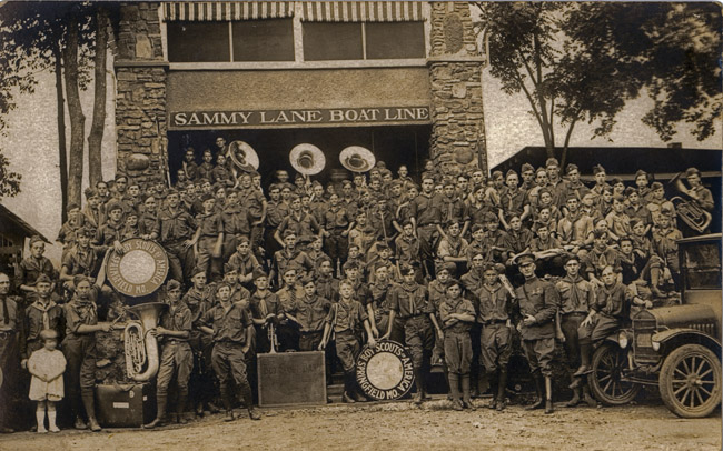 The Boy Scout Band from Springfield, Missouri posed in front of Sammy Lane Boat Line  on Lake Taneycomo in Branson, Missouri.