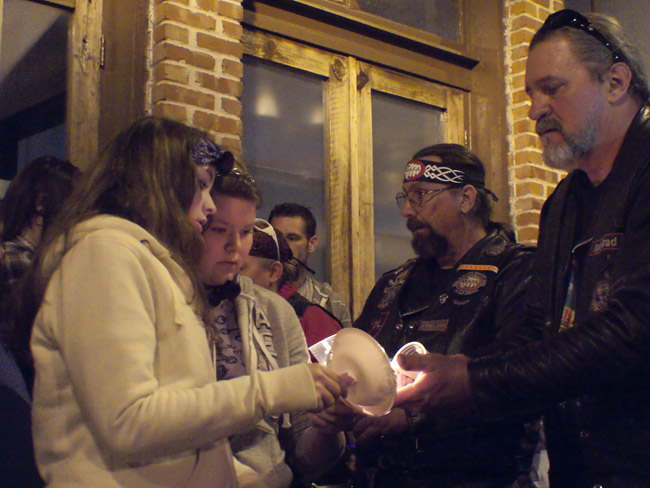 BACA, Bikers of Against Child Abuse lit the candles of Hailey's family at the start of the candle light vigil