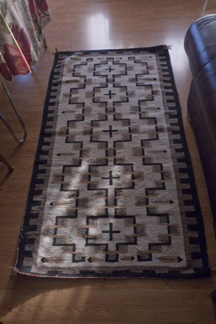 This Two Gray Hills rug was bought by my aunt Edna Kingston. She was an  elementary  in Alamosa, Colorado during 1920's.