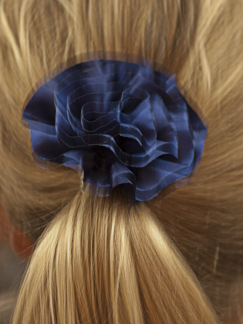 Blond hair and a blue hair bow