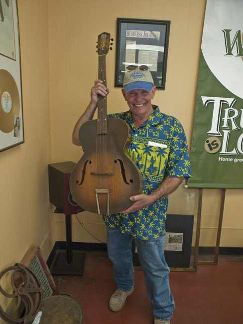 A portrait of Ruell Chapell with his Old Kraftsman archtop guitar, circa 2011