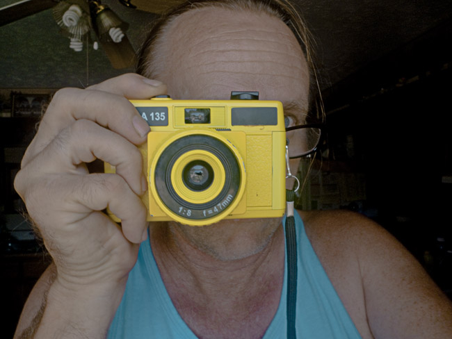 Self Portrait with Yellow Holga 135
