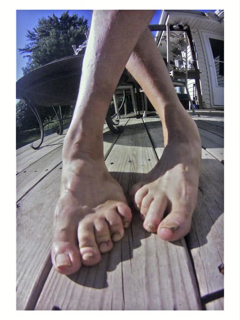 My crossed bare feet, a strange self-portrait, a Little Cyclops photo