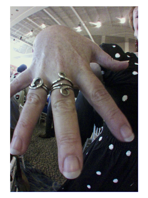 Moon's hand with silver rings, a Little Cyclops photo