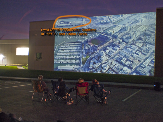 Game 3 of the 2014 World Series in San Francisco as seen projected on the outside wall of Hi Vee. From 1986-1989 I worked for Continental Maritime. The shipyard was at Pier 50 and China Basin (circled in Orange at the top left of the photo). During those years that I worked at Continental Maritime the landscape was vacant railroad yards loaded with toxic waste.