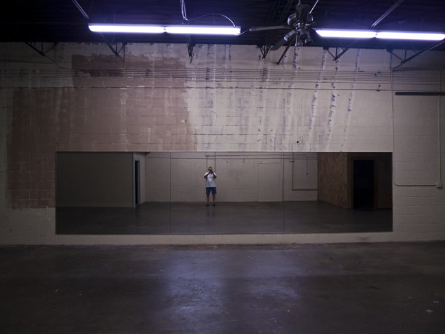 A self portrait in an empty dance studio.