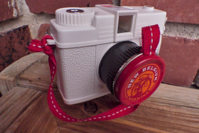 The Digital Diana sported a custom lens cap, made from the top of a New Belgium bicycle tire patch kit with a strip of gross grain ribbon as the lanyard. If anyone still has any of these patch tins lying around they are the perfect size for this application. New Belgium no longer makes this style of patch kit. If you have any please let me know.
