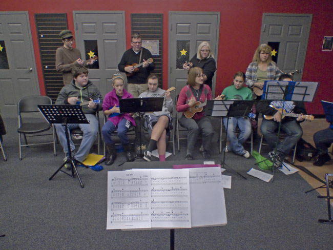 The Queen City Ukulele Club rehearsed Christmas Carols with the Jarrett Middle School Ukulele Club