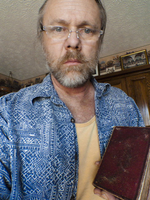 This a portrait of myself James Kent Radke holding the family bible.