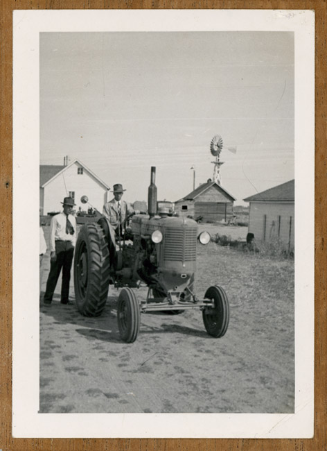 Sunday on Butch Sprick's farm in Sedgwick, County, Colorado. Left to right; Grandfather Walter Sprick and Butch Sprick.