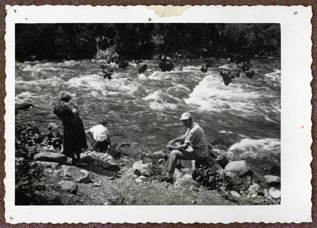 Bertha and Walter Sprick lounging on the banks of Poudre Canyon.