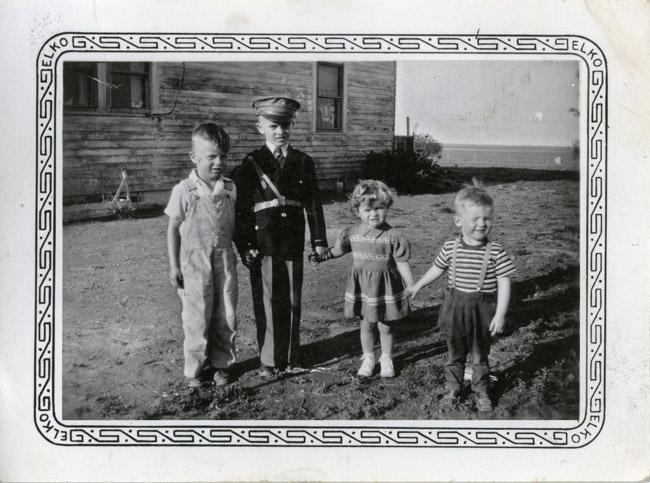 Richard (Dick) Radke, Bernard (Sonny or Junior) Radke, Sharon Radke and Ron Peterson at the farm on the Nebraska side of the Colorado/Nebraska State-line Road