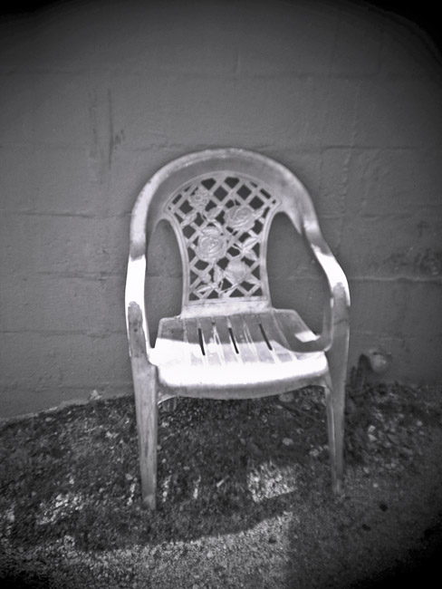 Plastic Garden Chair, 100 Photographs of the Mundane