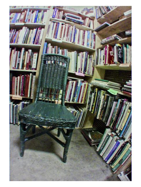 Green wicker chair in Flea Market Library