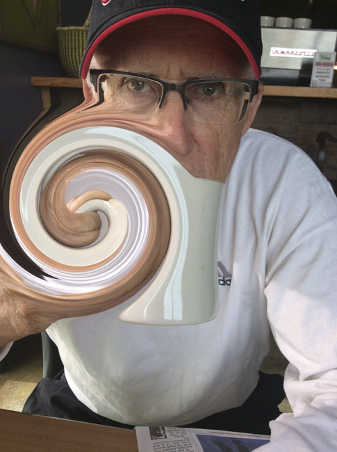Twisted portrait of Stan and his cup of coffee