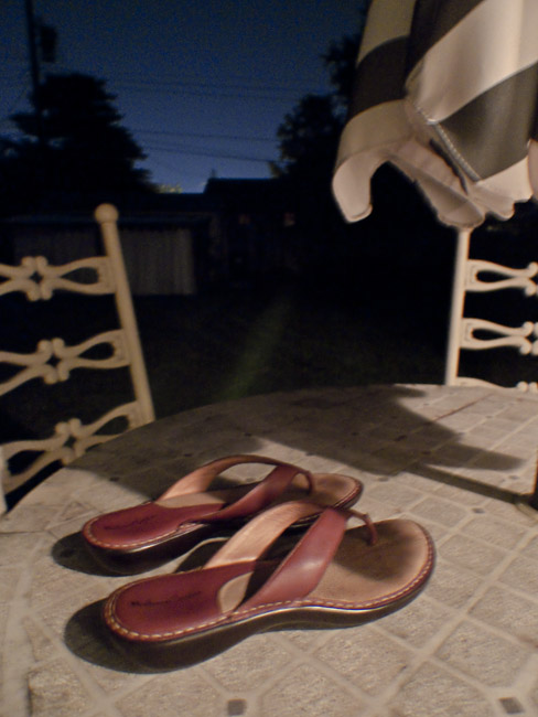 Sandals on patio table