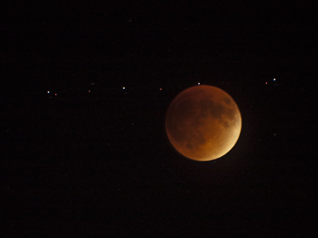 The Lunar Eclipse of the Blood Moon with an airplane passing by, image 2