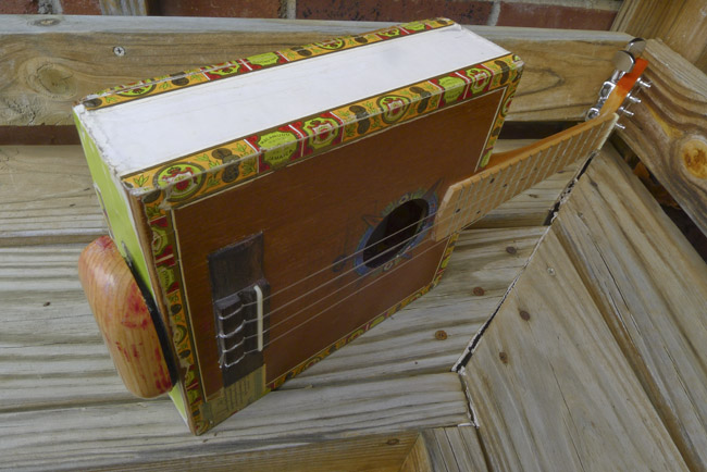 Horizontal view of Ukulele with the forearm wrest attached.