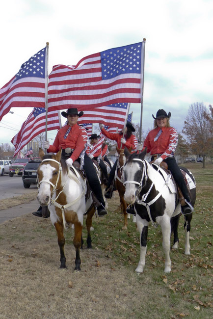 Smiling Happy girls on their horses and American flags.