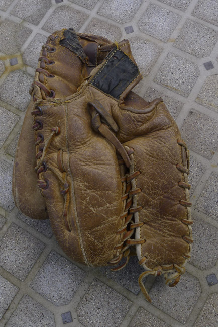 My father's baseball glove. Greg, Mike, David and myself all learned to catch and throw with this six fingered glove. The brand is no longer visible but it was a s good glove.