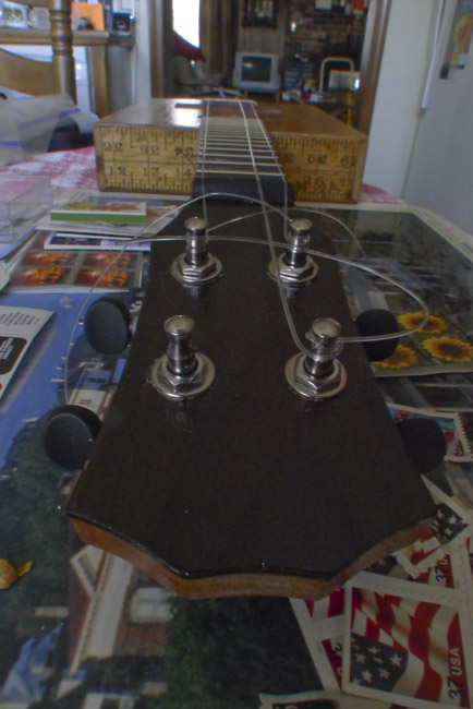 "The headstock of the ""$100 Dollar Bill"" concert ukulele"