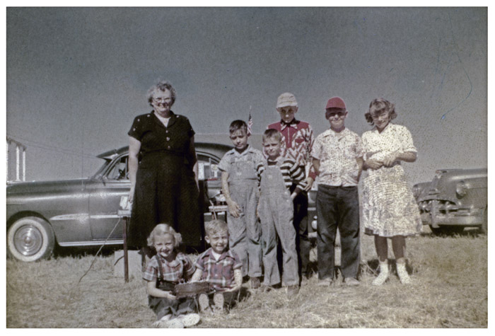 Outside a one room country school near Julesburg, Colorado. The teacher is my grandmother Bertha Sprick and her students celebrating a couple of birthdays.