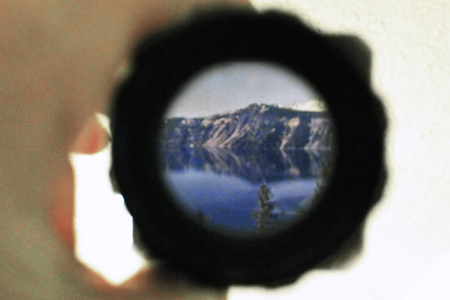 Hand, loupe and Crater Lake transparency