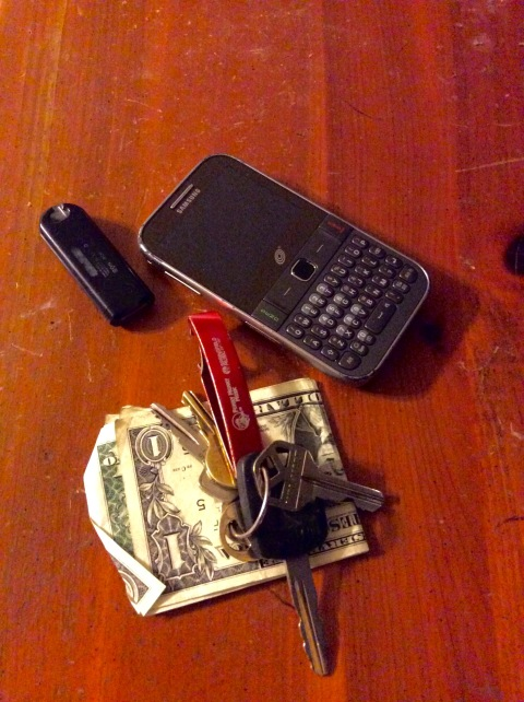 Cash, keys, flash drive, cell phone and bottle opener