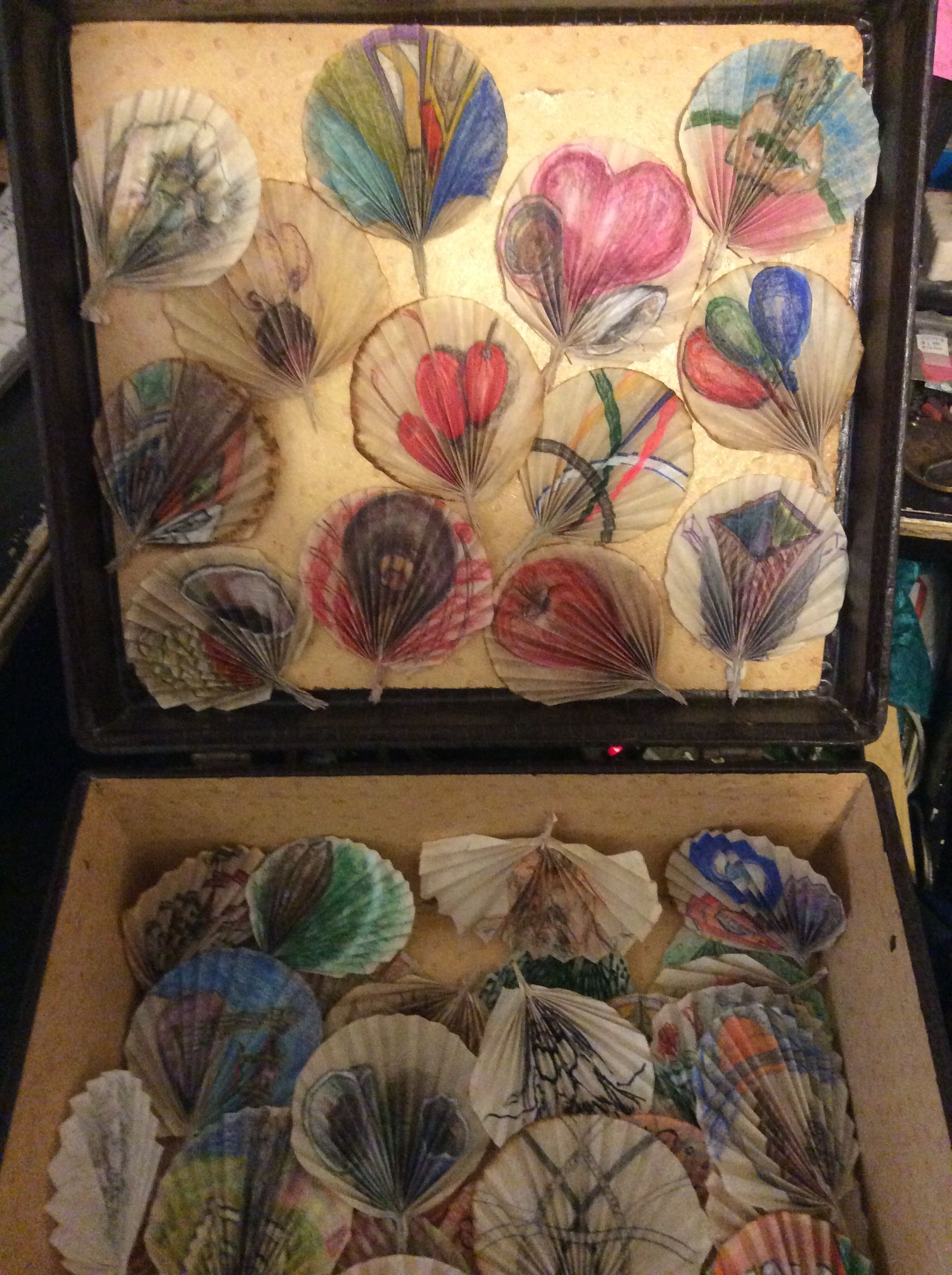 An old suitcase filled with cone filter drawings.