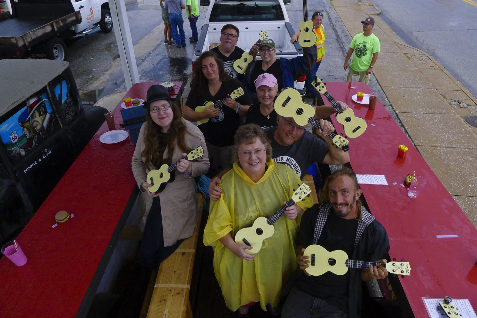 "Our informal but fun group the Queen City Ukulele Club got to ride on a float ""The Birthplace of Route 66 Festival"" parade. We must have played Route 66 at least 12 times. It was a rainy day so the plastic Waterman Ukes were brought out."