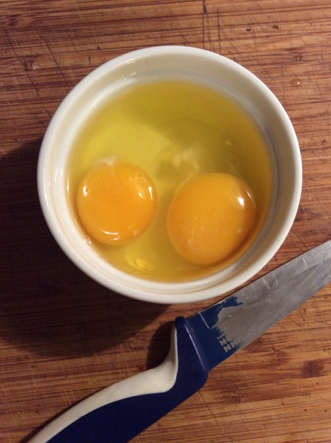 Two eggs and a paring knife